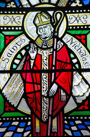 saint nicholas: A Victorian stained glass window depicting Saint Nicholas.  Over 100 years old.