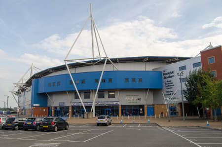 READING, UK - SEPTEMBER 14, 2014:  Main entrance to the Madejski sports stadium in Reading, Berkshire.  Home for Reading Football Club and London Irish Rugby Club.  View from public pavement.