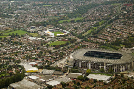 stoop: Aerial view over Twickenham, West London, with the large, international Rugby ground used by the England team to the right hand side and the smaller, Stoop Memorial Ground - home to Harlequins Rugby Club in the middle. Editorial