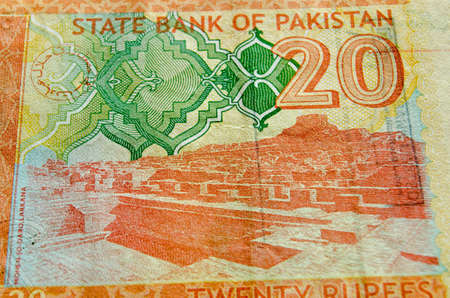 depicted: The Archeological site Mohen-jo-Daro in the Larkana district of Sindh province as depicted on part of a 20 rupee banknote from Pakistan.  Used banknote, photographed at an angle with less than 80% showing. Stock Photo