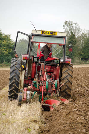 accredited: BASINGSTOKE, UK  OCTOBER 12, 2014:  A competitor in the conventional ploughs section of the British National Ploughing Championships organised by the Society of Ploughmen.  Accredited photographer.