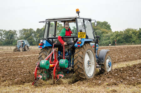 ploughing: BASINGSTOKE, UK  OCTOBER 12, 2014: Aled Morgan competing in the second day of the British National Ploughing Championships organised by the Society of Ploughmen.  Taking part in the semidigger conventional ploughs class.  Accredited photographer Editorial
