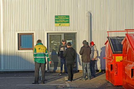 BASINGSTOKE, UK - DECEMBER 29, 2014:  Workers and contractors outside the City Link depot in Basingstoke.  After hearing the company had gone bust on Christmas Day this was the first opportunity they had to find out if they still had jobs.