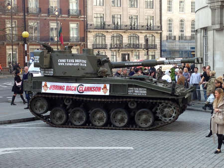bbc: LONDON, UK - MARCH 20, 2015:  A tank driven by The Stig delivering a petition to the BBC in support of Jeremy Clarkson.  The presenter has been suspended from Top Gear after a fracas with a producer.