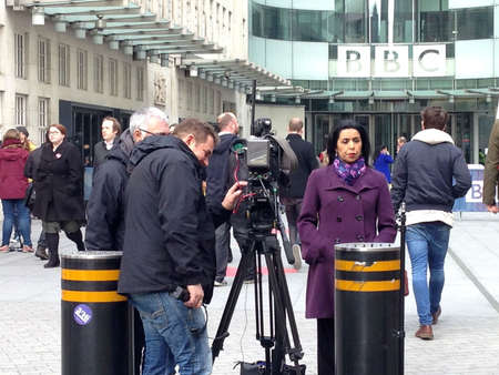 sacked: LONDON, UK - MARCH 25, 2015:  ITN reporter Nina Nannar covering the sacking of Jeremy Clarkson for punching a producer on Top Gear.  BBC Broadcasting House headquarters, London.