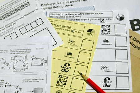 conservatives: BASINGSTOKE UK  MAY 3 2015:  Ballot forms for postal voting in the local and general election for May 2015.