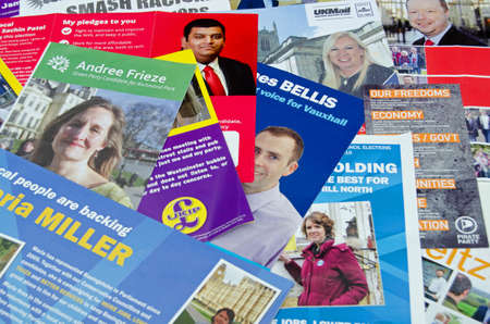 local election: BASINGSTOKE UK  MAY 3 2015:  Election leaflets from candidates of different parties competing in ballots in several constituencies in the UK for both the local and General Election.