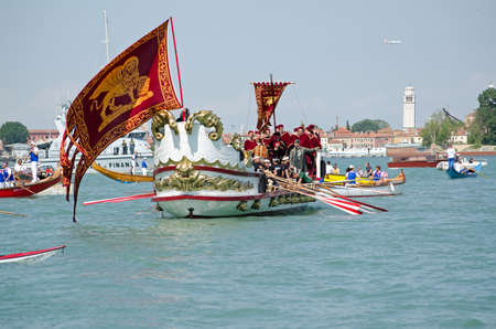 VENICE ITALY  MAY 17 2015:  An ornate boat carrying musicians and VIPs being rowed across the Lagoon from St Marks to Lido as part of the Marriage of the Sea ceremony to mark Ascension Day in Venice. Editorial