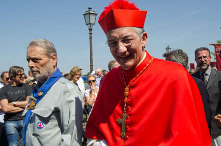clergyman: VENICE ITALY  MAY 17 2015:  The Patriarch of Venice  Francesco Moraglia  walking through crowds of spectators during the Festa della Sensa marking Ascension Day.  He has just presided over the Marriage of the Sea ceremony. Editorial