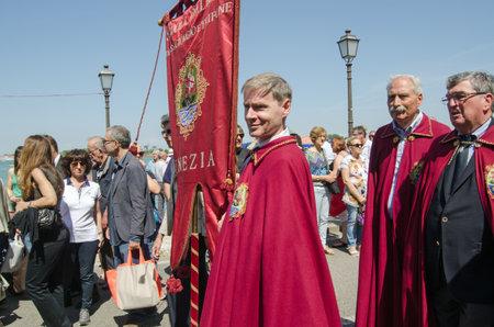 lido: VENICE ITALY  MAY 17 2015:  Representatives from the Scuola Dalmata dei SS Giorgio e Trifone taking part the parade on Lido as part of the Festa della Sensa.  The Ascension Day event includes the Marriage of the Sea ceremony.