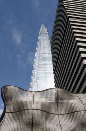shard of glass: Three different textures and three materials on modern buildings in Southwark London.  Woven metal concrete and sleek glass.  The landmark Shard skyscraper together with parts of Guys Hospital in Southwark Inner London.