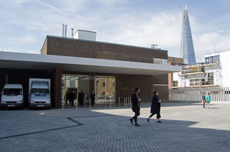 white cube: LONDON UK  APRIL 12 2015:  Pedestrians outside the trendy contemporary White Cube art Gallery in the hip district of Bermondsey inner London on a sunny Sunday in April.