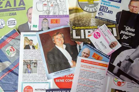 mayoral: VENICE ITALY  MAY 24 2015: Selection of leaflets and pamphlets from various contestants for the local regional and Mayoral elections in Venice to be chosen on May 31 2015.