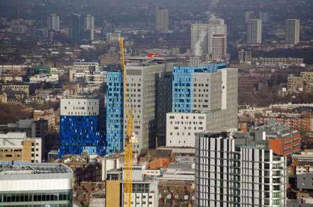 hamlets: View from the air of the striking new buildings for the historic Royal London Hospital in Whitechapel London.  The London Air Ambulance is based at the East London NHS hospital and its red helicopter can be seen perched on the roof. Editorial