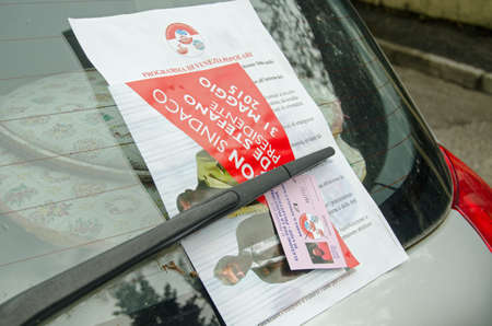 mayoral: VENICE ITALY  MAY 26 2015:  Election leaflets for the centre left Venezia Popolare group of parties left on a car windscreen ahead of local and mayoral elections in the city.