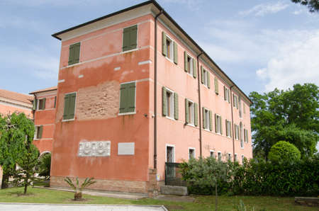 byron: Part of the accommodation block for visitors at San Lazzaro degli Armeni the Armenian Monastery on San Lazaro in Venice.  A plaque on the wall marks that the British poet Lord Byron stayed in the monastery for years. Editorial