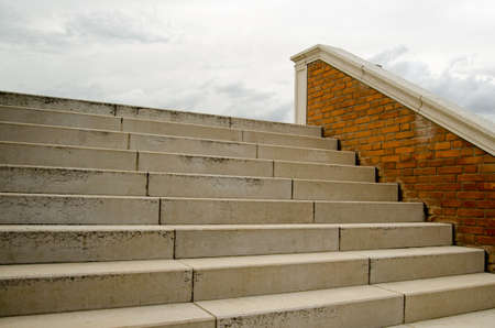 onwards: Stone steps leading to the sky or nowhere on a cloudy day. Stock Photo