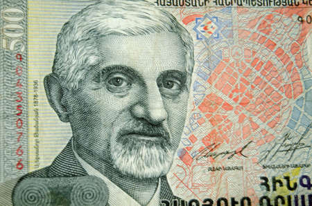 dram: Detail of a five hundred Dram banknote from Armenia showing the famous architect Alexander Tamanian.  Used banknote less than 80 showing photographed at an angle. Stock Photo