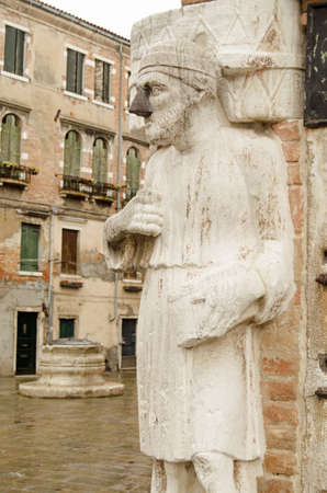 nose job: Historic stone statue of a Moorish trader believed to be a member of the Levantine Mastelli family with a repair to his nose.  Castello Venice.
