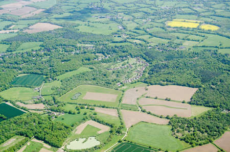 typically english: View from above of farmland in the Surrey Hills at the villages of Parkgate and Newdigate near Dorking. Stock Photo