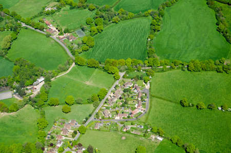 typically british: View from the air of the village of Capel in the Surrey countryside.