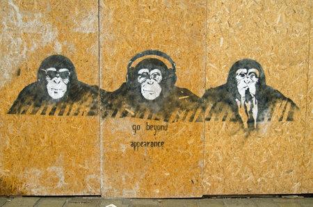 interpretation: VENICE ITALY  MAY 22 2015:  Graffiti painting of three cool wise monkeys with a modern day interpretation of hear no evil see no evil speak no evil.  Cannaregio Venice.