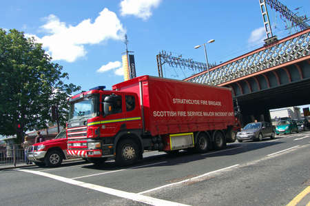 fire brigade: GLASGOW, UK - JULY 23, 2007:  A lorry carrying specialist equipment for the Major Incident Unit for Strathclyde Fire Brigade, part of the Scottish Fire Service.  Sunny July day in central Glasgow. Editorial
