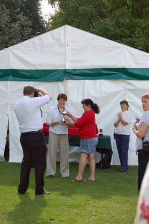 conservative: BASINGSTOKE, UK - JULY 7, 2007: Local Member of Parliament Maria Miller presenting a trophy to a winning competitor at the Basingstoke Flower and Vegetable Show in July 2007.  The Conservative politician has represented the town since 2005. Editorial