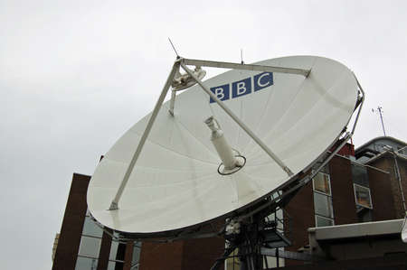 programmes: LONDON, UK - AUGUST 18, 2007:  A large satellite dish at BBC Television Centre in Shepherds Bush, West London.  The broadcasting organisation transmits programmes around the world. Editorial