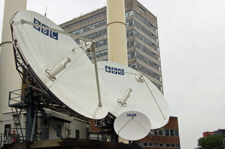 bbc: LONDON, UK - AUGUST 23, 2007: A cluster of satellite dishes outside BBC Television Centre in Shepherds Bush, West London.