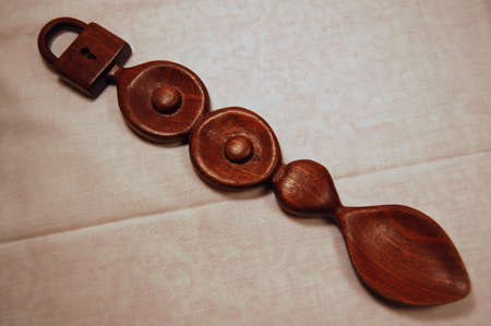 A hand carved wooden love spoon from Wales.  Traditionally given from one lover to another as a token of appreciation. Stock Photo