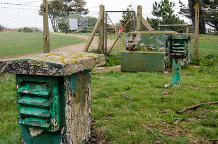 access point: Ventilation shafts and access point for a Royal Observer Corps Monitoring Post at Stone Point, Hampshire.  Staff in the bunker would measure radiation to warn of a nuclear bomb attack.  The bunker is being renovated as a heritage project to mark the cold