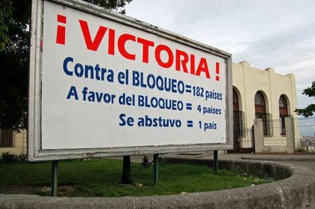 imposed: HAVANA, CUBA - NOVEMBER 19, 2005: Propaganda poster in Vedado, Havana marking the latest vote in the UN General Assembly over the US imposed blockade of Cuba. Editorial