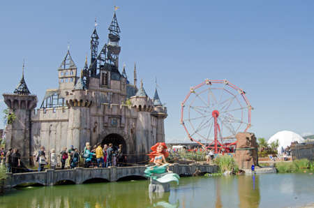 castle: WESTON-SUPER-MARE, UK - AUGUST 26, 2015: A Little Mermaid sculpture supposedly distorted by a toxic lake outside the Cinderella Castle at Dismaland, a parody park at the traditional seaside resort Weston-Super-Mare, Somerset.