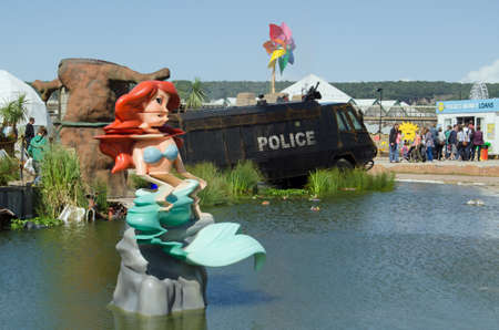 parody: WESTON-SUPER-MARE, UK - AUGUST 26, 2015:  The Little Mermaid mutated by chemicals at the toxic lake at Dismaland in Weston-Super-Mare.  The Banksy inspired parody fairground has attracted thousands of visitors each day.
