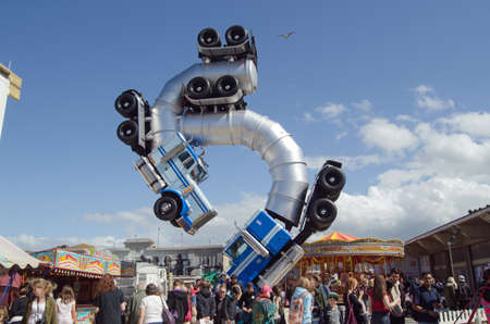parody: WESTON-SUPER-MARE, UK - AUGUST 26, 2015:  A seagull flies over the top of the truck ballet sculpture by Mike Ross at the Banksy inspired Dismaland theme park parody in Weston-Super-Mare, Somerset. The ironic attraction has attracted thousands of visitors