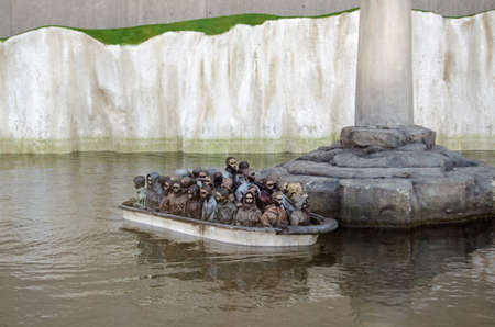 WESTON-SUPER-MARE, UK - AUGUST 26, 2015:  A traditional funfair attraction of remote controlled boats recreated by Banksy to reflect the issue of migrants trying to get into the UK.  Visitors can control one of three boats with migrants or a patrol vessel