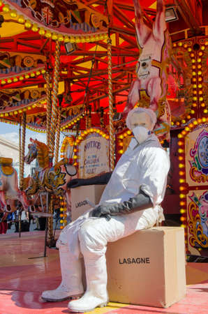 parody: WESTON-SUPER-MARE, UK - AUGUST 26, 2015: A parody of a horse carousel with an abattoir worker preparing horsemeat lasagne at Dismaland, the ironic theme park by Banksy at Weston-Super-Mare, Somerset.