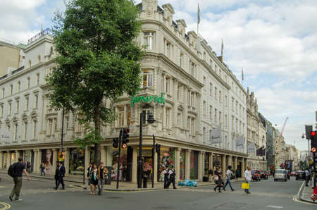 bond street: LONDON, UK - JUNE 15, 2015: The fashion department store Fenwick on New Bond Street in a part of Central London popular with high spending shoppers.  Westminster, Summer.