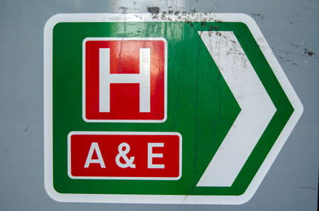 nhs: Sign on an A road showing the direction of the local hospital and the accident and emergency department. Stock Photo