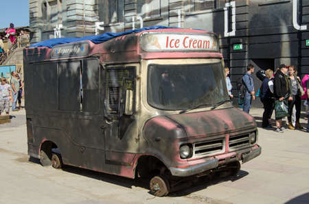 ironic: WESTON-SUPER-MARE, UK - AUGUST 26, 2015:  A burnt out ice cream van operating at the Dismaland parody theme park inspired by Banksy at the traditional seaside resort of Weston-Super-Mare.  The ironic funfair has attracted thousands of visitors.