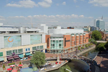 oracle: READING, UK - SEPTEMBER 10, 2015:  Aerial view of the River Kennet in the centre off Reading, Berkshire as pedestrians and shoppers enjoy the early afternoon sunshine at the Oracle Shopping Centre.