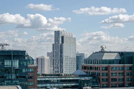 tower block: View across the City of London towards Spitalfields and a tower block of student accommodation.  Seen from a tall building on a sunny afternoon in September. Stock Photo