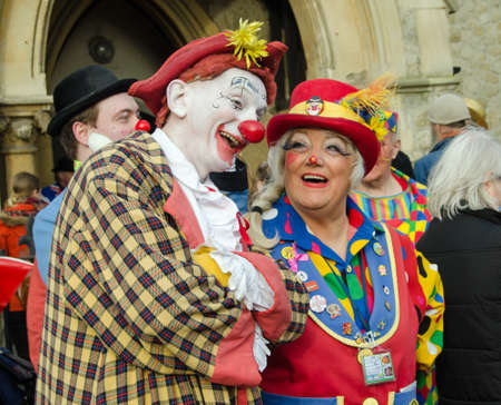 pip: HACKNEY, LONDON - FEBRUARY 7, 2016: Female clown Pip jokes with a colleague before the Annual Clown Service in memory of Joseph Grimaldi held at All Saints Church, Haggerston, Hackney in Londons East End. Editorial