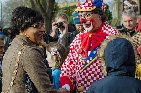 municipal editorial: HACKNEY, LONDON - FEBRUARY 7, 2016:  Councillor Sade Etti, Deputy Speaker of Hackney Council, is welcomed to the Annual Clown Service by Bluebottle, also known as Tony Eldridge of Clowns International.  All Saints Church, Haggerston, where clowns are hold Editorial