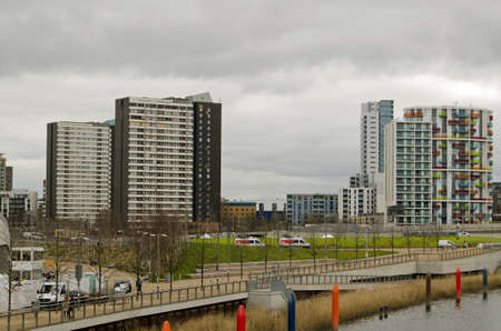 threatened: LONDON, UK - MARCH 19, 2016:  Old blocks of flats forming the Carpenters Estate on the left with modern blocks of flats on the right viewed from Queen Elizabeth Park in Stratford, London.  The old flats are threatened with demolition.