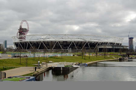 newham: The new West Ham United Stadium in Queen Elizabeth Park, .  With the Orbit tower behind and the Lee Navigation canal on the right.  Cloudy afternoon in March.