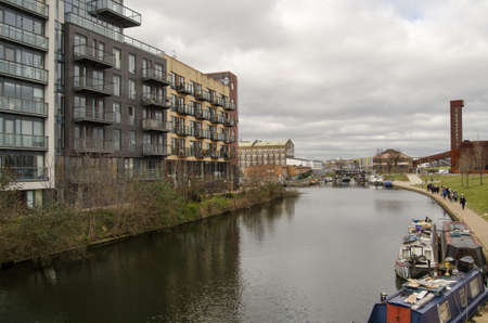 newham: Walkers enjoying the views on a cloudy March day along the Lee Navigation, a canalised part of the River Lea running between Hackney Wick and the Queen Elizabeth Park in Newham, East London.  .