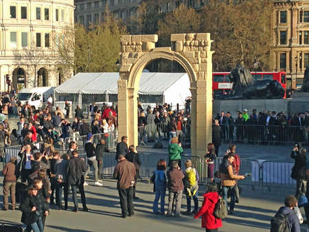 arch: LONDON, UK - APRIL 19, 2016:  Crowds in Londons Trafalgar Square surrounding a recreation of the historic Arch of Triumph from the Syrian city of Palmyra.  The ruin has been recreated using 3D printed marble and will travel the world.