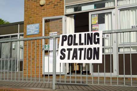 polling station: BASINGSTOKE, UK - MAY 5, 2016:  Entrance to a polling station at a primary school in Basingstoke, Hampshire on election day.
